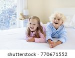 kids playing in parents bed in... | Shutterstock . vector #770671552
