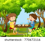two girls having picnic in the... | Shutterstock .eps vector #770672116