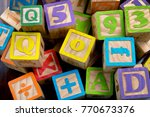 wooden toy building letter... | Shutterstock . vector #770673376