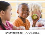students outdoors eating lunch  ... | Shutterstock . vector #77073568
