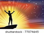 A joyous man with arms stretched  up to a glorious sky. - stock photo