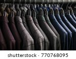 row of men suit jackets on... | Shutterstock . vector #770768095