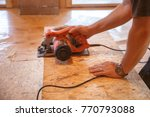 worker using professional saw ... | Shutterstock . vector #770793088