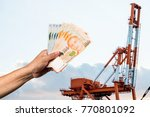 hand hold a singapore currency... | Shutterstock . vector #770801092