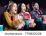 excited friends with popcorn... | Shutterstock . vector #770833228