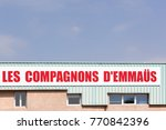 Small photo of Sassenage, France - June 24, 2017: Companions Emmaus sign on a wall. Emmaus is an international solidarity movement founded in Paris in 1949 by the Catholic priest Abbe Pierre