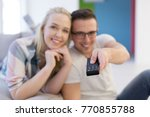 young couple on the sofa...   Shutterstock . vector #770855788