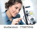 female mechanic mending machine ... | Shutterstock . vector #770875546