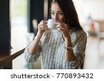 beautiful woman drinking coffee ... | Shutterstock . vector #770893432