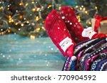 feet in christmas socks. girl... | Shutterstock . vector #770904592