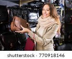 smiling woman buying leather...   Shutterstock . vector #770918146