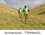 senior tourist couple hiking at ... | Shutterstock . vector #770946652