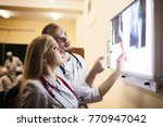 a group of doctors discusses...   Shutterstock . vector #770947042