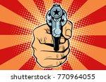 star revolver in hand. pop art... | Shutterstock .eps vector #770964055