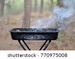 smoking empty black mangal... | Shutterstock . vector #770975008