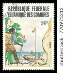 Small photo of Comoros - stamp printed 1982, Multicolor memorable Edition of offset printing with Topic Scouts, Series 75 Years of Scouting, Scout boat