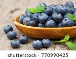 blueberries in a wood bowl on a ... | Shutterstock . vector #770990425