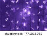 silver star garland on ultra... | Shutterstock . vector #771018082