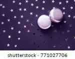 two silver macaroons on dark... | Shutterstock . vector #771027706