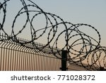 fence with barbed wire...   Shutterstock . vector #771028372