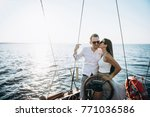 a girl kisses her beloved guy... | Shutterstock . vector #771036586
