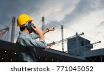 engineer is pointing the job... | Shutterstock . vector #771045052