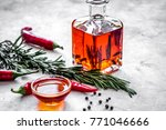jar with oil and chili on stone ... | Shutterstock . vector #771046666