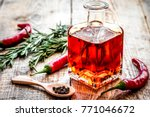 oil in carafe with spices and... | Shutterstock . vector #771046672