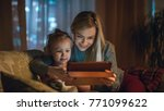 beautiful mother and her little ... | Shutterstock . vector #771099622
