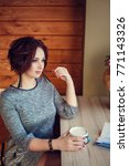 cute woman drinking coffee in... | Shutterstock . vector #771143326