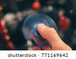 spinner in man's fingers with... | Shutterstock . vector #771169642