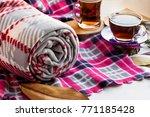 rolled grey polar blanket on... | Shutterstock . vector #771185428