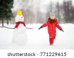little boy playing with funny... | Shutterstock . vector #771229615
