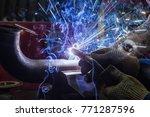 close up of a welder in... | Shutterstock . vector #771287596