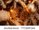 Small photo of New Year background. New Year's garland and fir tree background. Fir tree Decorated By Lights Presents Gifts Toys, Candles And Garland Lighting.