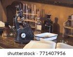 antique laboratory  microscope... | Shutterstock . vector #771407956