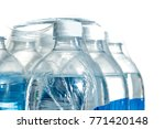 Small photo of Closeup of a pack of 1,5 liter bottled water