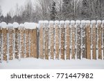 wooden fence in the snow | Shutterstock . vector #771447982