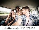 hippie friends driving on a... | Shutterstock . vector #771524116