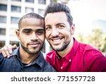 happy gay couple spending time... | Shutterstock . vector #771557728