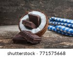 coconut with chocolate on old... | Shutterstock . vector #771575668