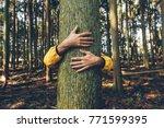 man hugging tree bark | Shutterstock . vector #771599395