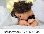 mom's love newborn. | Shutterstock . vector #771606136