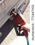 hand holding diesel fuel pump...   Shutterstock . vector #771667432