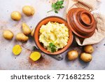 mashed potato in bowl and on a... | Shutterstock . vector #771682252
