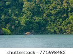 a scenery of a sea and a... | Shutterstock . vector #771698482
