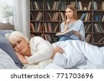 granddaughter taking care of... | Shutterstock . vector #771703696