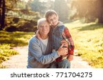 grandfather and grandson... | Shutterstock . vector #771704275