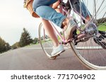 couple riding bicycle together... | Shutterstock . vector #771704902