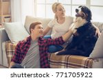 young people with dog at home... | Shutterstock . vector #771705922